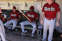 OAKLAND, CA - JULY 3:  Coach Alan Trammell #3, coach Don Baylor #25 and coach Matt Williams #9 of the Arizona Diamondbacks get ready in the dugout before the game against the Oakland Athletics at the Oakland-Alameda County Coliseum on July 3, 2011 in Oakland, California. Photo by Brad Mangin