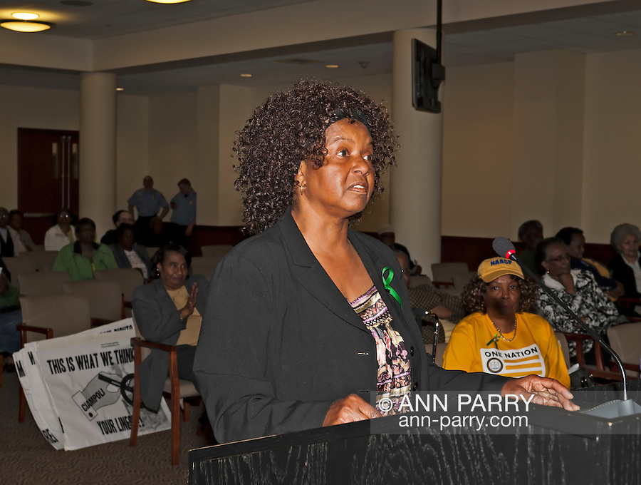 MAY 9, 2011 - MINEOLA: At public hearing, woman speaking against the Nassau County Legislative Redistricting proposal, at Nassau County Executive and Legislative Building at 1550 Franklin Avenue, Mineola, New York, USA on May 9, 2011