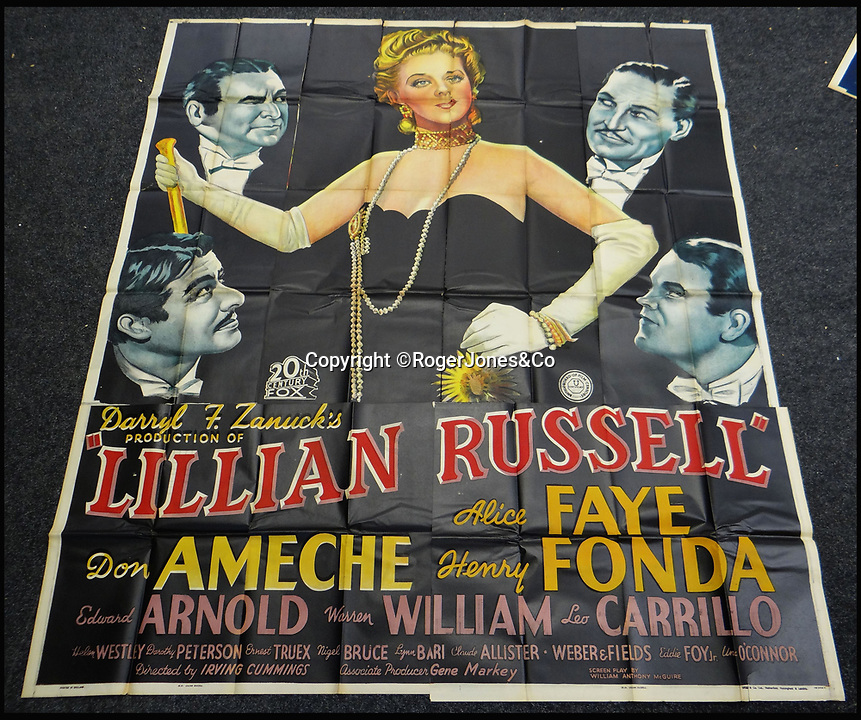 BNPS.co.uk (01202 558833)<br /> Pic: RogerJones&Co/BNPS<br /> <br /> Poster for the Lillian Russell musical.<br /> <br /> A rare collection of 1930s and 40s cinema posters discovered by two builders after they were used as carpet underlay have sold for a whopping £75,000.<br /> <br /> More than half the total was made on a single poster, John Wayne's breakthrough film Stagecoach (1939), which sold for £31,000.<br /> <br /> The classic Hollywood movie posters, which were in near pristine condition, are from the halcyon days of cinema and included well known names such as Alfred Hitchcock, Sir Laurence Olivie and Boris Karloff.<br /> <br /> Before the sale auctioneers Rogers Jones & Co said it was difficult to predict what the posters would sell for as no comparisons had ever come to market but the collection of about 120 posters was expected to fetch several thousands.<br /> <br /> Two builders made the discovery in 1985 when they were renovating the home of a local cinema owner who had died in Penarth, south Wales.
