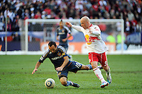 Luke Rodgers (9) of the New York Red Bulls fouls Landon Donovan (10) of the Los Angeles Galaxy during the 1st leg of the Major League Soccer (MLS) Western Conference Semifinals at Red Bull Arena in Harrison, NJ, on October 30, 2011.