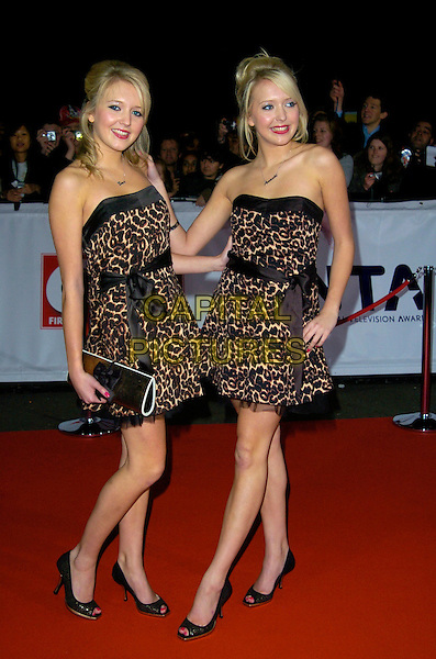 SAM & AMANDA MARCHANT.The National Television Awards, Royal Albert Hall, .London, England, October 31st, 2007..TV NTA full length matching leopard print strapless dress dresses Twins Big Brother  sisters .CAP/CAN.©Can Nguyen/Capital Pictures