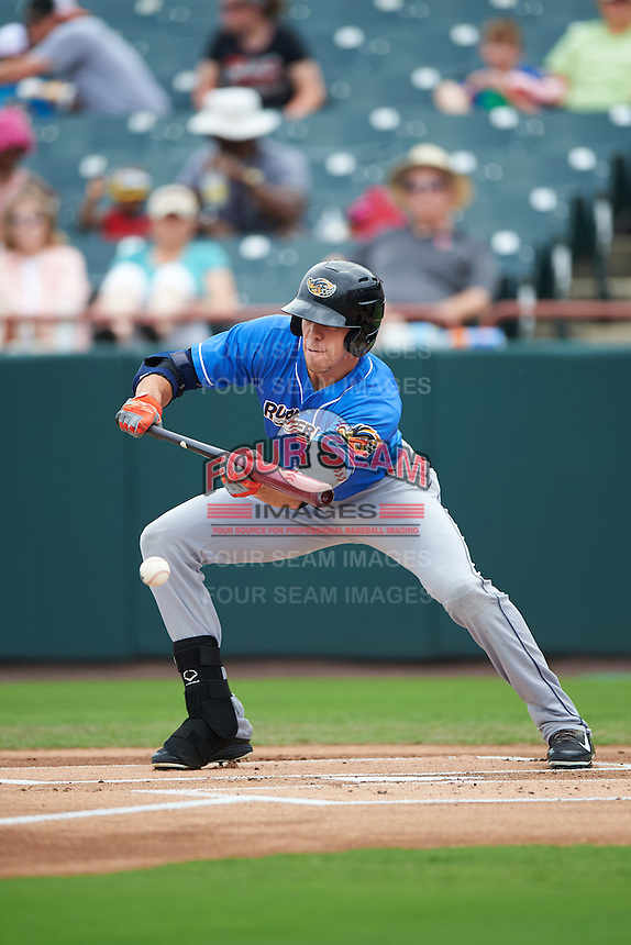 Akron RubberDucks center fielder Bradley Zimmer (6) lays down a bunt during the first game of a doubleheader against the Bowie Baysox on June 5, 2016 at Prince George's Stadium in Bowie, Maryland.  Bowie defeated Akron 6-0.  (Mike Janes/Four Seam Images)
