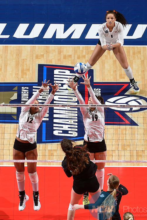 COLUMBUS, OH - DECEMBER 17:  Morgan Johnson (12) and Paulina Prieto Cerame (19) of the University of Texas attempt a block against Stanford University during the Division I Women's Volleyball Championship held at Nationwide Arena on December 17, 2016 in Columbus, Ohio.  Stanford defeated Texas 3-1 to win the national title. (Photo by Jamie Schwaberow/NCAA Photos via Getty Images)