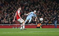 Leeds United's Ezgjan Alioski with a shot under pressure from Arsenal's Sokratis Papastathopoulos<br /> <br /> Photographer Rob Newell/CameraSport<br /> <br /> Emirates FA Cup Third Round - Arsenal v Leeds United - Monday 6th January 2020 - The Emirates Stadium - London<br />  <br /> World Copyright © 2020 CameraSport. All rights reserved. 43 Linden Ave. Countesthorpe. Leicester. England. LE8 5PG - Tel: +44 (0) 116 277 4147 - admin@camerasport.com - www.camerasport.com