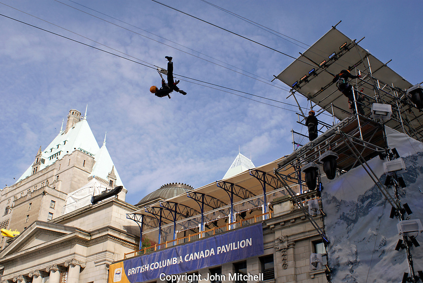 Person ziplining over Robson Square in downtown Vancouver, 2010 Winter Olympic Games, Vancouver, British Columbia Canada.