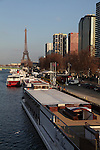 Modern high rise buildings on Left Bank of river Seine with Eiffel Tower La tour eiffel in the background. City of Paris. Paris. France