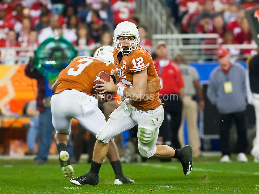 Jan 05, 2009; Glendale, AZ, USA; Texas Longhorns quarterback Colt McCoy (12) fakes a handoff to running back Chris Ogbonnaya (3) and rolls out of the pocket in the third quarter of the Fiesta Bowl against the Ohio State Buckeyes at University of Phoenix Stadium.  The Longhorns won the game 24-21.
