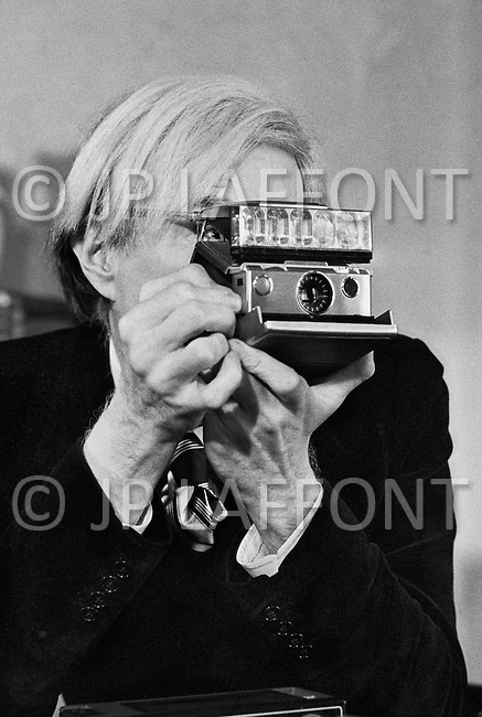 March 1st, 1974, New York City.<br /> <br /> Andy Warhol in his office on Union Square.<br /> Wit a true passion for photography, the artist was immediately taken by the Polaroid innovation of instantenous camera.<br /> <br /> First the instantaneous nature of the result - you no longer need to have a roll developed and wait for 1 or 2 days to see the photos.<br /> Then the immediate gratification of being able to show and share his pictures with his entourage<br /> <br /> <br />  Le 1er mars 1974, New York City<br /> <br /> Andy Warhol dans son bureau d'Union Square.<br /> L'artiste passionn&eacute; de photographie a tout de suite &eacute;t&eacute; s&eacute;duit par l'arriv&eacute; du Polaroid.<br /> <br /> D'abord l'instantan&eacute;it&eacute; du r&eacute;sultat, on ne doit plus aller faire d&eacute;velopper son film et attendre 1 ou 2 jours pour voir les photos.<br /> Enfin le plaisir imm&eacute;diat de partager et de montrer ses photos autour de lui.
