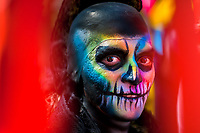 A Mexican man, having his face colorfully painted with skull, takes part in the Day of the Dead celebrations in Mexico City, Mexico, 29 October 2016. Day of the Dead (Día de Muertos), a syncretic religious holiday combining the death veneration rituals of the ancient Aztec culture with the Catholic practice, is celebrated throughout all Mexico. Based on the belief that the souls of the departed may come back to this world on that day, people gather at the gravesites in cemeteries praying, drinking and playing music, to joyfully remember friends or family members who have died and to support their souls on the spiritual journey.