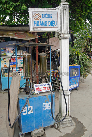 Asia, Vietnam, Hoi An. Hoi An nr. old quarter. Small volumes of petrol for the many small motorbikes are sold almost everywhere. The historic buildings, attractive tube houses, and decorated community halls have 1999 earned Hoi An's old quarter the status of a UNESCO World Heritage Site. To protect the old quarter's character stringent conversation laws prohibit alterations to buildings, as well as the presence of cars on the roads.