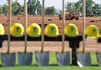 Jun. 16, 2009; Casa Grande, AZ, USA; Construction vehicles work during the groundbreaking of the Casa Grande Training Facility & Performance Institute in Casa Grande.  Mandatory Credit: Mark J. Rebilas-