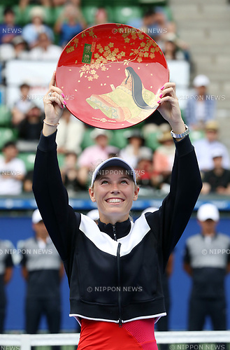 September 24, 2017, Tokyo, Japan - Defending champion Caroline Wozniacki of Denmark raises the trophy of the Toray Pan Pacific Open tennis championships in Tokyo on Sunday, September 24, 2017. Wozniacki defeated Pavlyuchenkova 6-0, 7-5 in the final and clinched the victory.    (Photo by Yoshio Tsunoda/AFLO) LWX -ytd-