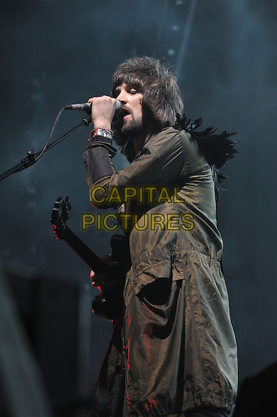 Sergio Pizzorno.Kasabian performing live in concert, O2 Arena, Greenwich, London, England. 14th December 2011.on stage gig performance music half length green jacket guitar singing beard facial hair side.CAP/MAR.© Martin Harris/Capital Pictures.