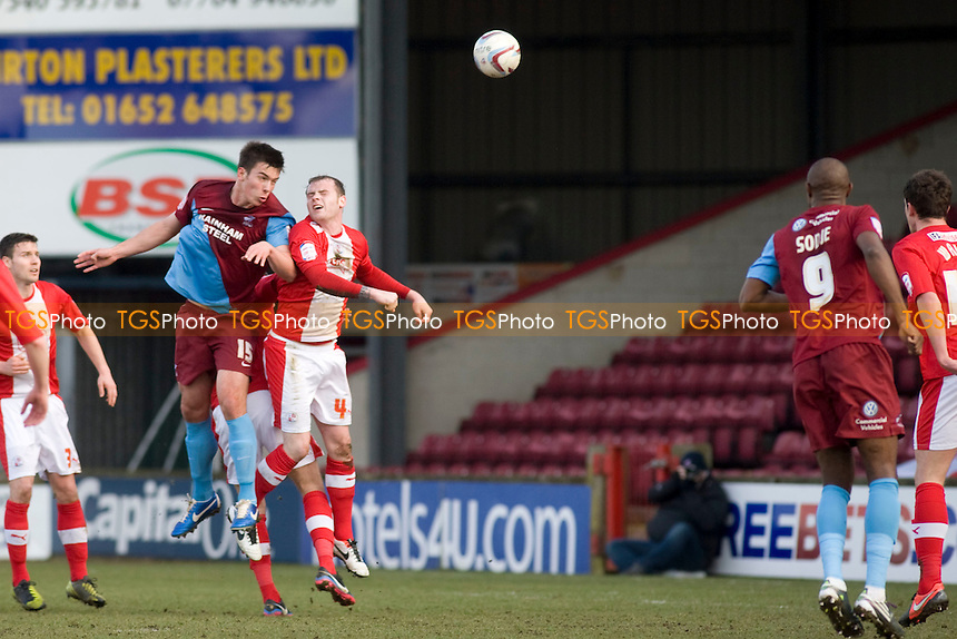Niall Canavan (Scunthorpe Utd) heads on goal. - Scunthorpe United vs Crawley Town - NPower League One Football at Glanford Park - 09/02/13 - MANDATORY CREDIT: Mark Hodsman/TGSPHOTO - Self billing applies where appropriate - 0845 094 6026 - contact@tgsphoto.co.uk - NO UNPAID USE.