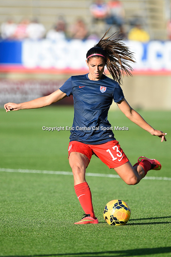 June 19, 2014 - East Hartford, Conn. U.S. -  United State's Alex Morgan (13) warms up before the USA Women's Soccer friendly game between USA and France held at Rentschler Field in East Hartford Connecticut. The match ended with a 2-2 tied score. Eric Canha/CSM