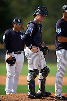 New York Yankees catcher Josh Breaux (20) looks on in a mound visit during a Florida Instructional League game against the Philadelphia Phillies on October 11, 2018 at Yankee Complex in Tampa, Florida.  (Mike Janes/Four Seam Images)
