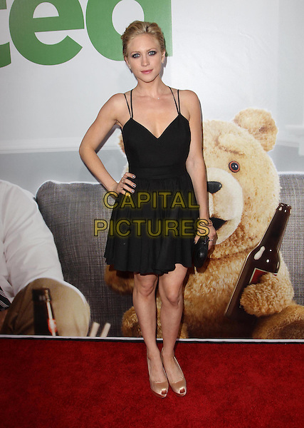 Brittany Snow.The L.A. Premiere of 'Ted' held at The Grauman's Chinese Theatre in Hollywood, California, USA..June 21st, 2012.full length black dress hand on hip clutch bag .CAP/ADM/KB.©Kevan Brooks/AdMedia/Capital Pictures.