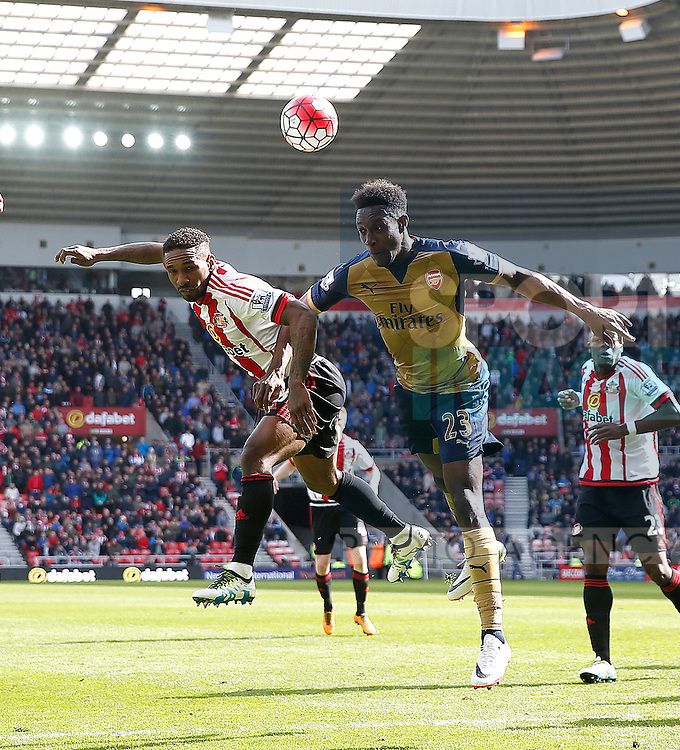 Jermain Defoe of Sunderland has his header blocked by Danny Welbeck of Arsenal during the Barclays Premier League match at  Stadium of Light. Photo credit should read: Simon Bellis/Sportimage