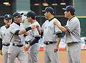 (L-R) Mick Kelleher, Ichiro Suzuki, Rob Thomson, Hiroki Kuroda, Masahiro Tanaka (Yankees),<br /> APRIL 1, 2014 - MLB :<br /> Ichiro Suzuki of the New York Yankees gets fist-bumps from his teammates Hiroki Kuroda and Masahiro Tanaka during introductions before the baseball game against the Houston Astros at Minute Maid Park in Houston, Texas, United States. (Photo by AFLO)