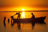 AJ2100, sunrise, sunset, boat, Chile, Two men in a fishing boat silhouetted against the sunrise on Lago Llanquihue in the South-Central Region (the Land of Lakes and Volcanoes) in Chile.