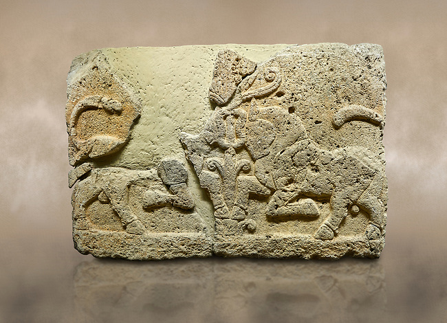 Hittite relief sculpted orthostat stone panel of Herald's Wall Limestone, Karkamıs, (Kargamıs), Carchemish (Karkemish), 900-700 B.C. Anatolian Civilisations Museum, Ankara, Turkey.<br /> <br /> A pair of kneeling bull on either side of the tree of life, one each foot is on the tree, the other feet are bend towards the abdomen.  <br /> <br /> Against a brown art background.