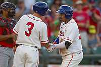 Wearing an Austin Senators throwback uniform, Round Rock Express designated hitter Manny Ramirez (39) is greeted by teammate Aaron Cunningham (3) after homering in the Pacific Coast League baseball game against the Oklahoma City RedHawks on July 9, 2013 at the Dell Diamond in Round Rock, Texas. Round Rock defeated Oklahoma City 11-8. (Andrew Woolley/Four Seam Images)