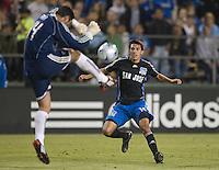 FC Dallas goalkeeper Dario Sala kicks the ball away from Earthquakes Shea Salinas. .The San Jose Earthquakes tied FC Dallas 0-0, at Buck Shaw Stadium, in Santa Clara, California, Saturday, May 3, 2008. .