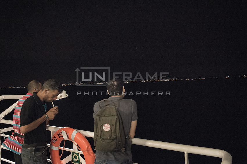 Syrian migrants during their ferry ride to Athens. Kos, Greece. Sept.  8, 2015