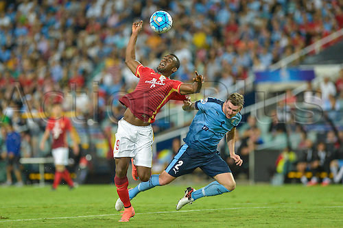 02.03.2016. Sydney, Australia. AFC Champions League. Sydney versus Guangzhou Evergrande. Evergrande forward Jackson Martinez is brought down in the penalty area by Sydney defender Sebastian Ryall and the referee awards a penalty kick.