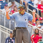 30 August 2015: MLB Umpire Dale Scott signals for new balls during a game between the Miami Marlins and the Washington Nationals at Nationals Park in Washington, DC. The Nationals rallied to defeat the Marlins 7-4 in the third game of their 3-game weekend series. Mandatory Credit: Ed Wolfstein Photo *** RAW (NEF) Image File Available ***