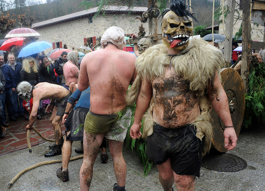 Masked people perform during an ancient carnival on January 27, 2014 at the village of Ituren, Basque Country. Joaldun groups perform an ancient traditional carnival at the villages of Ituren and Zubieta during two days, carrying sheep furs and big cowbells in their backs and making sound them in order to wake up the earth, to ask for a good new year, a good harvest and also to keep away the bad spirits. (Ander Gillenea / Bostok Photo)