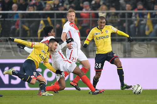 10.01.2017. Stade Bonal, Montbéliard, France. French League cup football, Sochaux versus Monaco.  Goran KARANOVIC (soc)challenges the run of JEMERSON (mon) supported by Faneva ANDRIATSIMA (soc) as Kamil GLIK (mon) watches play