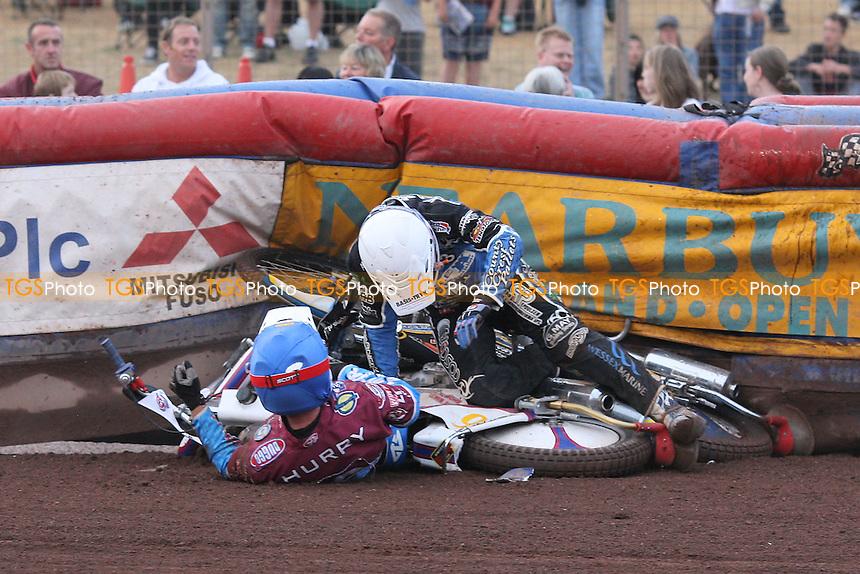 Heat 7: Paul Hurry (blue) crashes out with Bjarne Pedersen - Lakeside Hammers vs Poole Pirates - Sky Sports Elite League Speedway at Arena Essex Raceway, Purfleet, Essex - 02/08/10 - MANDATORY CREDIT: Gavin Ellis/TGSPHOTO - Self billing applies where appropriate - Tel: 0845 094 6026