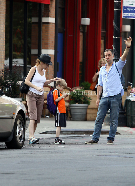 WWW.ACEPIXS.COM . . . . .  ....June 21 2011, New York City....Actress Edie Falco, her son Anderson and director Eric Mendelsohn hail a cab in Tribeca on June 21 2011 in New York City....Please byline: CURTIS MEANS - ACE PICTURES.... *** ***..Ace Pictures, Inc:  ..Philip Vaughan (212) 243-8787 or (646) 679 0430..e-mail: info@acepixs.com..web: http://www.acepixs.com