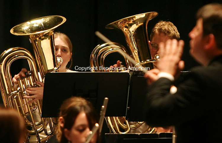 TERRYVILLE, CT 06/09/08- 060908B04- Tuba players Christine Tartaglia and Kyle Konopaske perform with the Terryville High School Concert Band under the direction of Tmothy Keane during &quot;A Spring Concert&quot; at the school Monday night.<br /> Jamison C. Bazinet Republican-American