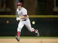 SANTA CLARA, CA - April 19, 2011: Danny Diekroeger of Stanford baseball runs to third during Stanford's game against Santa Clara at Stephen Schott Stadium. Diekroeger would later score his first collegiate run. Stanford won 10-3.