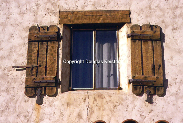 Scotty's Castle<br />Death Valley California<br />This plain steel window with its flaring reveal is embellished with a heavily rusticated pair of shutters and a stout wooden lintel.  Steel windows, an innovation of the Twenties, proved fairly popular in residential architecture before their propensity to rust became evident.   They returned to residential work for a brief encore during the Modernist era before aluminum windows superceded them.