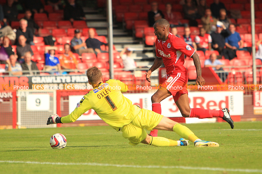 Emile Sinclair of Crawley Town rounds Mark Oxley of Oldham Athletic only to put the ball wide - Crawley Town vs Oldham Athletic - Sky Bet League One Football at the Broadfield Stadium Crawley, West Sussex - 28/09/13 - MANDATORY CREDIT: Simon Roe/TGSPHOTO - Self billing applies where appropriate - 0845 094 6026 - contact@tgsphoto.co.uk - NO UNPAID USE