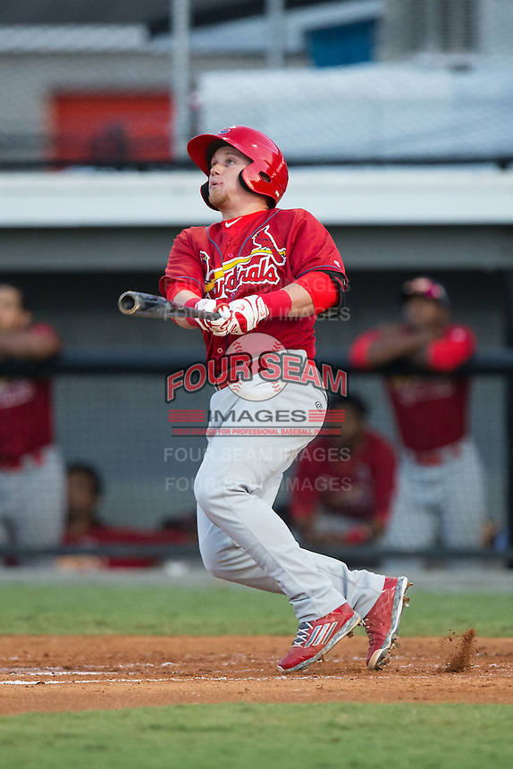 Allen Staton (40) of the Johnson City Cardinals follows through on his swing against the Burlington Royals at Burlington Athletic Park on August 22, 2015 in Burlington, North Carolina.  The Cardinals defeated the Royals 9-3. (Brian Westerholt/Four Seam Images)