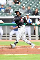 Birmingham Barons center fielder Luis Robert (26) swings at a pitch during a game against the Tennessee Smokies at Smokies Stadium on May 15, 2019 in Kodak, Tennessee. The Smokies defeated the Barons 7-3. (Tony Farlow/Four Seam Images)