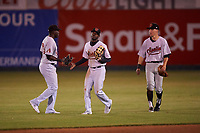 Visalia Rawhide outfielders Yoel Yanqui (29), Anfernee Grier (10), and Jake McCarthy (31) celebrate a victory after a California League game against the San Jose Giants on April 12, 2019 at San Jose Municipal Stadium in San Jose, California. Visalia defeated San Jose 6-2. (Zachary Lucy/Four Seam Images)