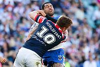 Adam Blair hit in a big tackle. Sydney Roosters v Vodafone Warriors, NRL Rugby League. Allianz Stadium, Sydney, Australia. 31st March 2018. Copyright Photo: David Neilson / www.photosport.nz