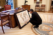 Washington, DC - June 10, 2009 -- United States President Barack Obama looks at a map donated to the White House by the National Geographic Society, in the Oval Office, June 10, 2009. .Mandatory Credit: Pete Souza - White House via CNP