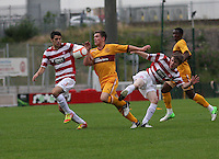 Craig Moore sandwiched between Stephen Hendrie (left) and Jack McCue in the Hamilton Academical v Motherwell friendly match played at New Douglas Park, Hamilton on 24.7.12..