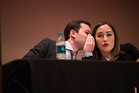 "Stanford debaters Andrew Chizewer and Danielle Danielle Mitalipov strategize during an exhibition debate between UAA and Stanford University at Loussac Library's Wilda Marston Theater. UAA's debate team bested Stanford's, arguing the pro on the night's question ""Is America Ready for Socialism?"""