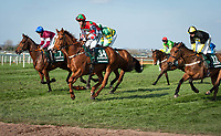 LIVERPOOL - APRIL 14: #34 Captain Redbeard leads a group across the Melling Road in the Randox Health Grand National Steeplechase at Aintree Racecourse in Liverpool, UK (Photo by Sophie Shore/Eclipse Sportswire/Getty Images)
