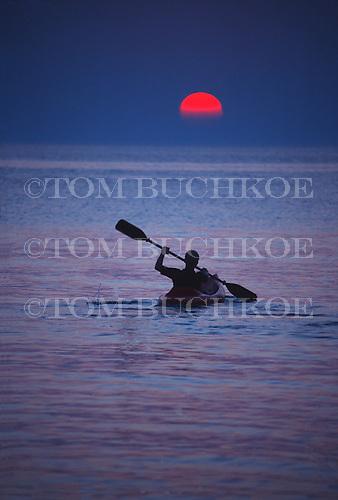 Kayaker on Lake Michigan at sunset.