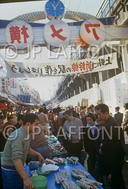October, 1980. Tokyo, Japan. The merchants sell various goods at the street market in Tokyo.