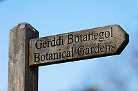 A bilingual Botanical Gardens / Gerddi Botanegol sign in English and Welsh in Singleton Park, Swansea, Wales, UK. Friday 27 March 2020