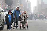 NEW YORK - FOR NEWS:  Building explosion, East 116th Street, between Madison and Park Aves, Harlem, NY Wednesday, March 12, 2014.  <br /> <br /> PICTURED:   A displaced family at the scene of the building explosion.<br /> <br /> (Angel Chevrestt, 646.314.3206)
